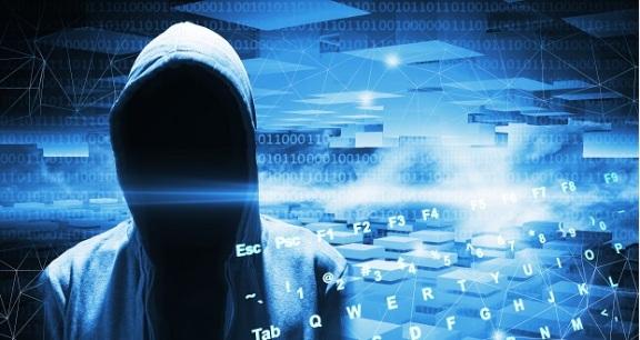Hacker in a hood on dark